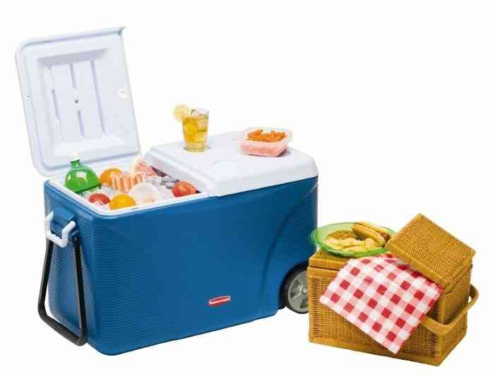 Portable cooler with wheels and a picnik basket